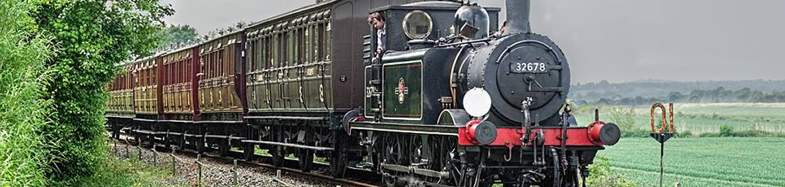 32678 works the K&ESR's train of magnificently restored Victorian carriages - May 2018. © Alan Crotty